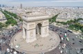 Around the Arc de Triomphe in Paris you give way to cars coming into the roundabout, rather than the cars already on it.