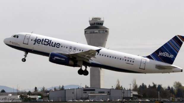 A JetBlue passenger received news he had tested positive to coronavirus during a flight from New York.