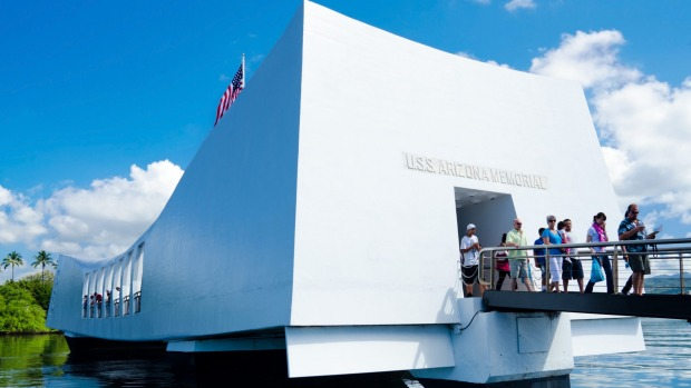 Visitors walking out from the USS Arizona Memorial.