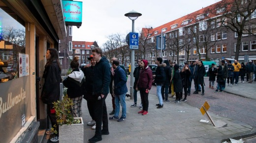 People queue to buy marijuana at coffeeshop Bulwackie in Amsterdam, Netherlands, after health minister Bruno Bruins ...