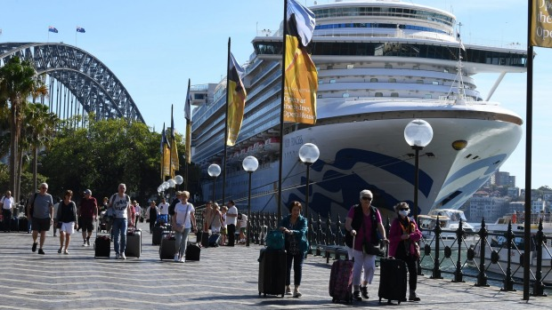 Cruise ship passengers disembark from Ruby Princess at Circular Quay, Sydney, last Thursday.