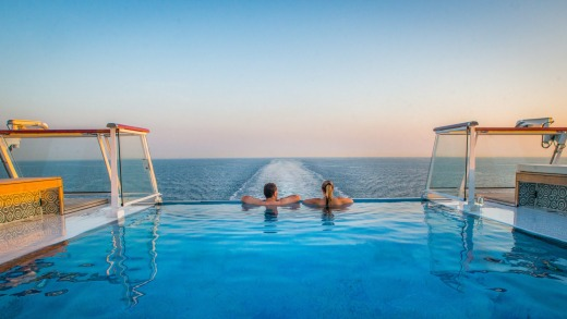 Couple enjoy the view from the Infinity Pool on-board the Viking Star.