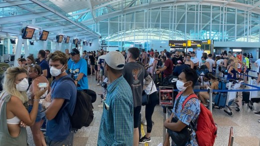 Dozens of Australians at Denpasar Airport look for flights home as the pandemic took hold.