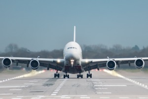 Gatwick Airport, England, UK – December 09 2018: Front on view straight down the runway of an Emirates Airline A380 ...