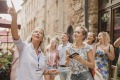It'll be a while before Australians can return to Italy. Pictured, a local guide shows tourists around Volterra, Italy.