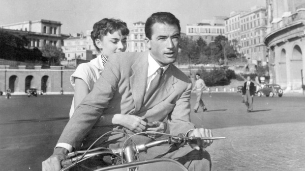 Audrey Hepburn and Gregory Peck in a Roman holiday.