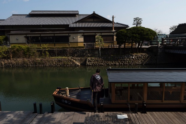 "A boatman prepares his boat in the Arashiyama district of Kyoto, Japan. ""Arashiyama is empty,"" is a new catchphrase that ..."