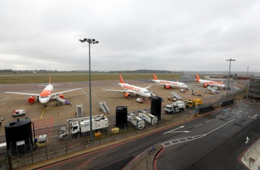 Easyjet planes sit parked at London Luton Airport. Britain's EasyJet has grounded its fleet of 344 planes and has no ...
