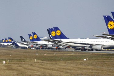 Grounded Lufthansa planes at Frankfurt Airport, Germany. The German carrier cut long-haul capacity by up to 90 per cent ...