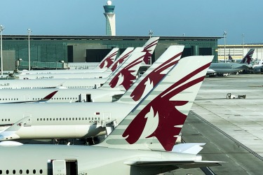 Qatar Airways planes grounded on Doha Airport, Qatar. While the airline has suspended somes routes, it has actually ...