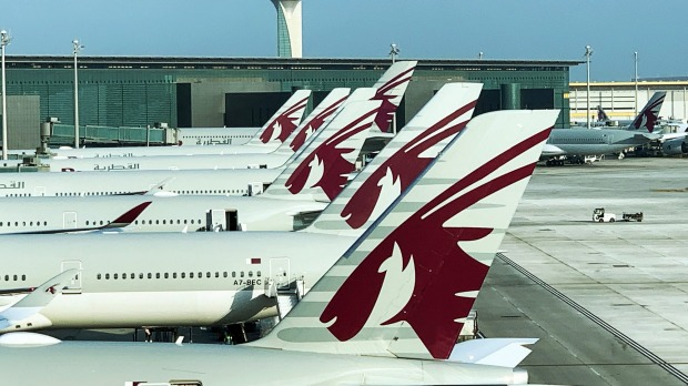 Qatar Airways planes grounded at Doha Airport.