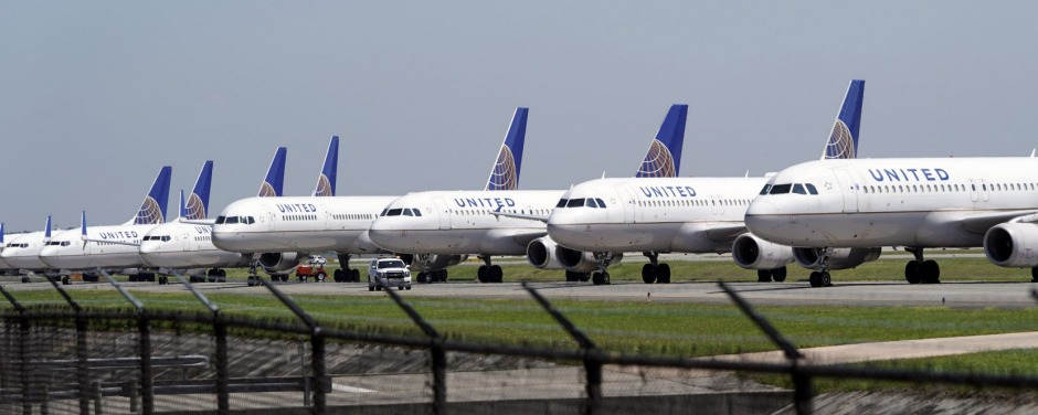 United Airlines planes are parked at George Bush Intercontinental Airport Wednesday, March 25, 2020. The airlines have ...