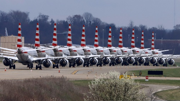 American Airlines planes stored at Pittsburgh International Airport sit idle on a closed taxiway in Imperial, Pa., on ...