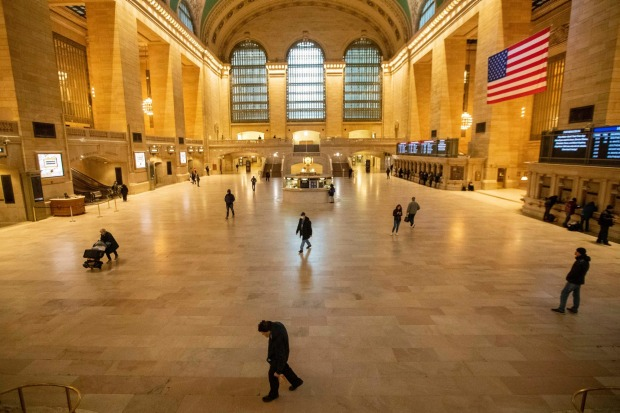 People make their way inside Grand Central Terminal in New York.