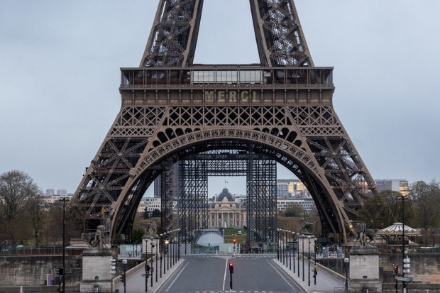 Eiffel Tower says 'Merci (thank you) to healthcare workers fighting virus as people across the country cheer and ...