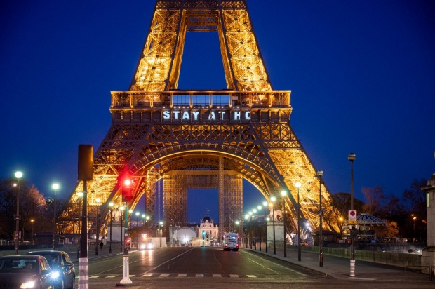 The Eiffel Tower displays messages saying 'Stay At Home' or 'Restez Chez Vous' on 14th day of general lockdown to fight ...