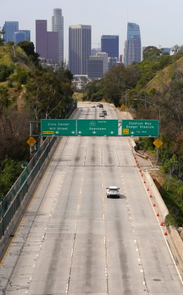 Light traffic moves along the Arroyo Seco Parkway toward downtown Los Angeles.
