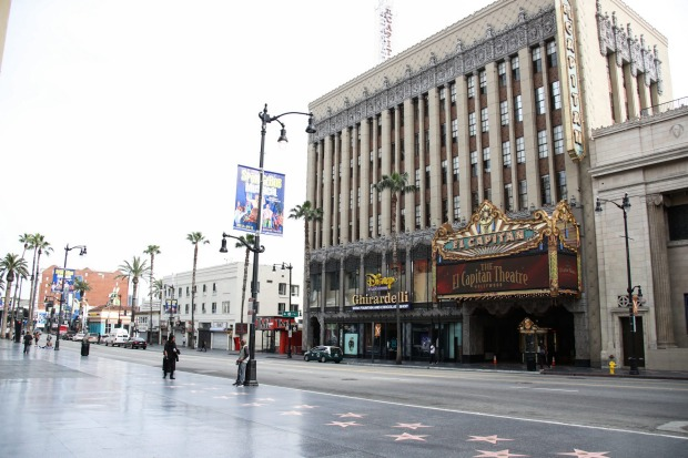 A view of the Hollywood Blvd Walk Of Fame and El Capitan Theatre in Hollywood, Los Angeles. Los Angeles tourism and ...