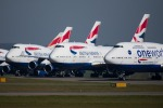 Grounded British Airways jumbo jets at Cardiff Airport in Wales. International Consolidated Airlines Group (IAG), the ...