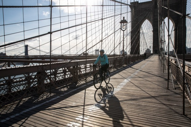 A cyclist gets the unusual distinction of having the Brooklyn Bridge in New York to themselves.