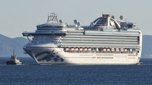 The Ruby Princess, carrying hundreds of sick crew, enters Port Kembla.
