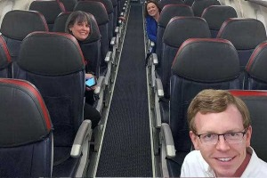 Dusty Johnson takes a selfie with colleagues on a mostly empty plane to Washington, DC.