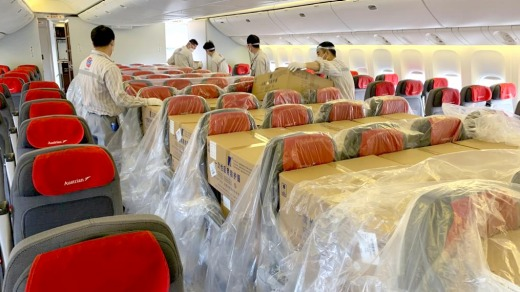 An Austrian Airlines passenger cabin filled with cargo.