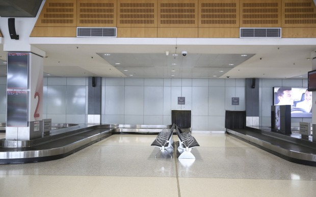 Sydney Domestic Airport, absent of crowds with flight cancellations due to the ongoing COVID-19 pandemic.