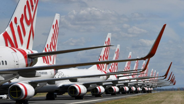Grounded Virgin Australia aircraft parked at Brisbane Airport.
