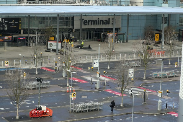 The empty forecourt outside Terminal 3 at London's Heathrow Airport Monday April 6, 2020.