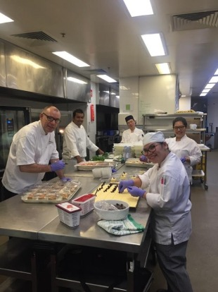 Boris Cuzon, front left, the Sofitel Wentworth's executive chef, and his team preparing meals for quarantined guests at ...