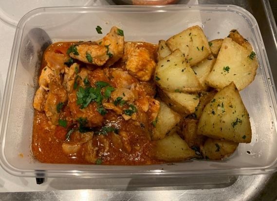 A main course of Basque-style braised chicken, consisting of capscum, zucchini, tomato, yellow squash, extra virgin ...
