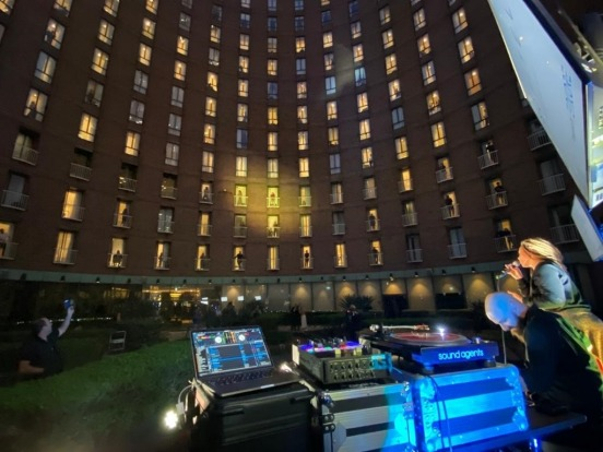 In the Garden Court terrace of the hotel, a member of the Soul Nights R and B band entertains quarantined guests at the ...