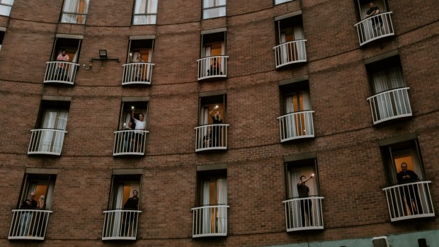 Guests on their balconies at the Sofitel Sydney Wentworth during a concert held for them in April last year.