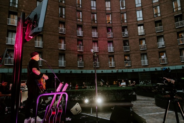 Diesel performs his three-song set for quarantined guests gathered on hotel room balconies or by windows.
