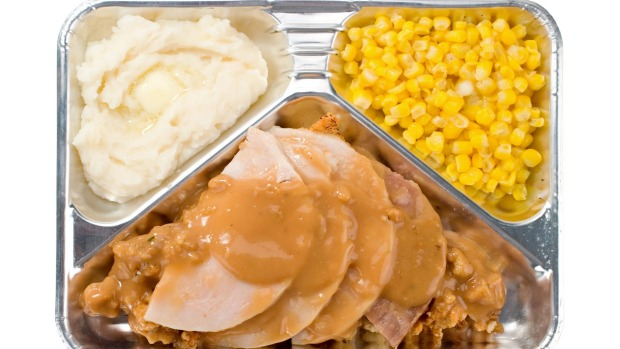 A microwave TV dinner can offer you all the joys of dining on a plane in the comfort of your own home.