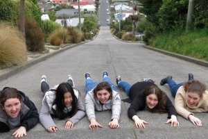 Students from Melbourne, Australia, pose for a photograph on Baldwin St, which is still the world's steepest street.