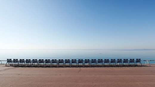 Empty chairs beside the beach on Promenade des Anglais avenue in Nice, France.