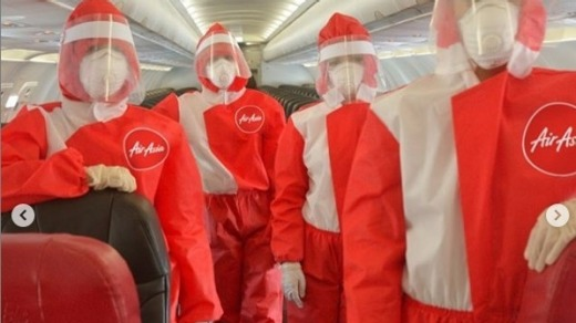 AirAsia's new uniforms for cabin crew feature PPE for coronavirus protection.