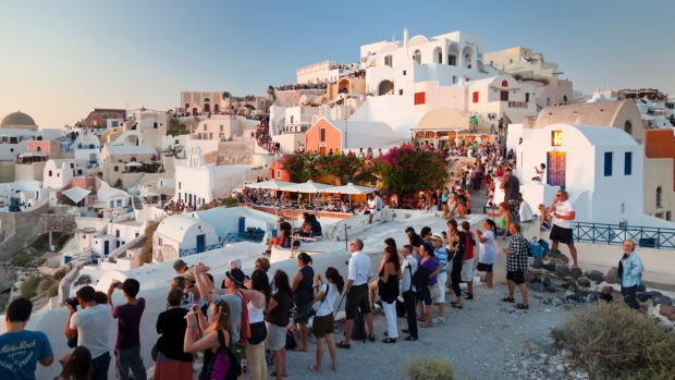 Tourists wait for the sunset at Oia, Santorini.