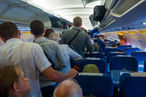 Airlines are creating the crowds by cancelling other flights and packing passengers on the few remaining planes.