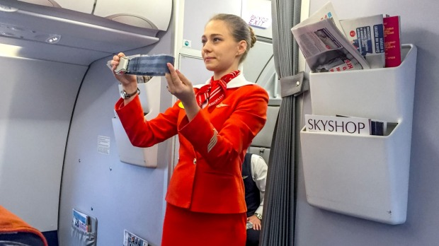 After landing, you'll hear flight attendants say 'disarm doors and ...' what?