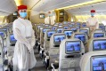 Emirates flight attendants will wear personal protective equipment on board planes.