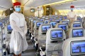 Emirates cabin crew are wearing PPE (personal protection equipment) on board flights.