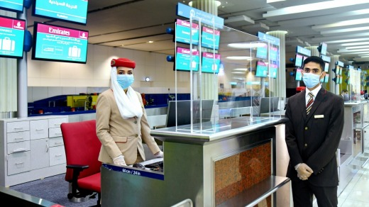 Check-in desks at Dubai Airport now feature protective screens.