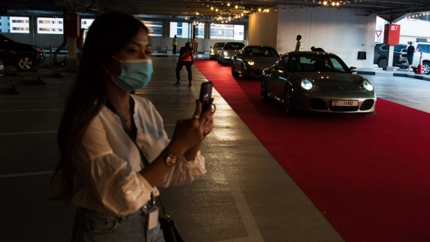 Porsche 911s drive up for a showing of Bad Boys For Life at the pop-up drive-in on top of the Mall of the Emirates.