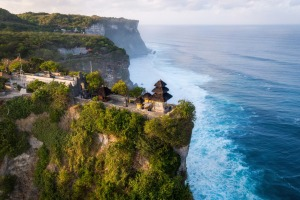 Aerial view of Pura Luhur Uluwatu temple at sunrise.
