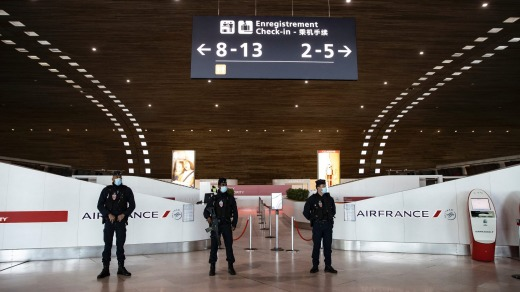 French police stand guard in Terminal 2 of Charles de Gaulle international airport, in Roissy near Paris, France.