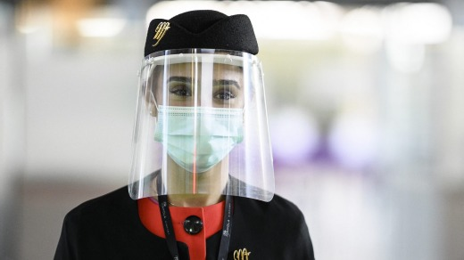 An Airport hostess wearing a mask at the Charles De Gaulle Airport.