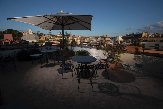The empty rooftop terrace of the art-deco style Locarno Hotel, in Rome.